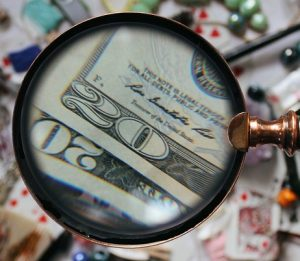 magnifying glass over money